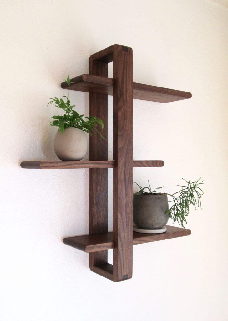 Shifting wall shelf by Liminal Studio